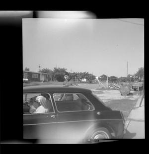 Primary view of object titled '[Byrd Williams IV prepares to get in a car]'.