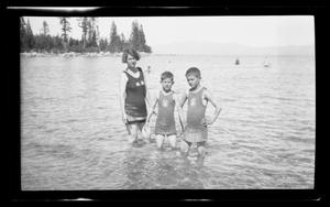 Primary view of object titled '[Irene, John, and Byrd Williams, III, standing in a lake]'.
