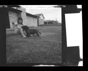 Primary view of object titled '[Pam Williams sitting near a house with Angus]'.