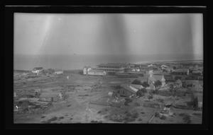Primary view of object titled '[Photo of a town near the ocean]'.