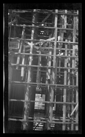 Primary view of object titled '[Construction site with wooden framework]'.