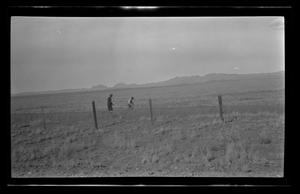 Primary view of object titled '[Two men working in a field]'.