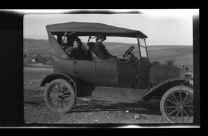 Primary view of object titled '[Irene, John, and Byrd Williams, III, sitting in their Model T]'.