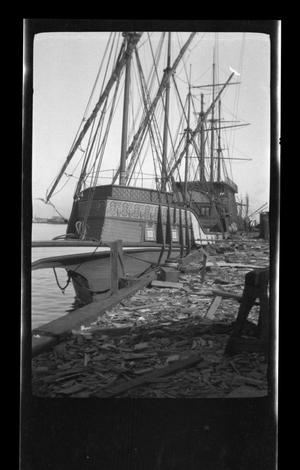 Primary view of object titled '[Photo of an old ship in a harbor]'.