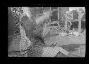 Primary view of object titled '[Long exposure of Irene Williams sitting outside]'.