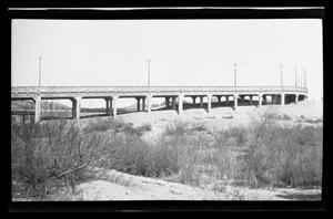 Primary view of object titled '[A photo of a bridge in a desert]'.