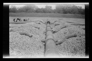 Primary view of object titled '[Photo of underground piping at a construction site]'.