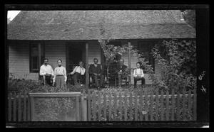 Primary view of object titled '[An unidentified family on their front porch]'.