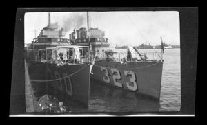 Primary view of object titled '[Photo of two ships in a port]'.