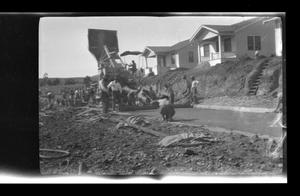 Primary view of object titled '[Men doing construction on a residential street]'.