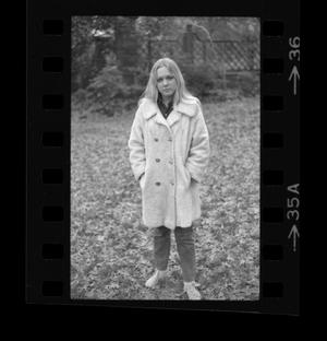 Primary view of object titled '[Dana Long standing in a park]'.