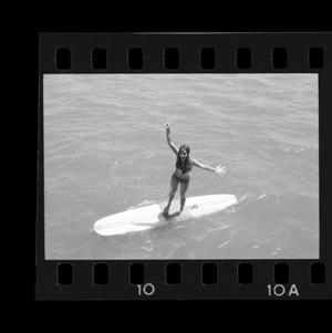 Primary view of object titled '[Girl standing on a surfboard at Nosh lake house]'.