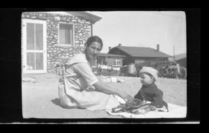 Primary view of object titled '[Irene Williams with her son Charles Williams]'.