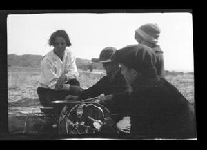Primary view of object titled '[Photo of Irene Williams supervising her sons]'.