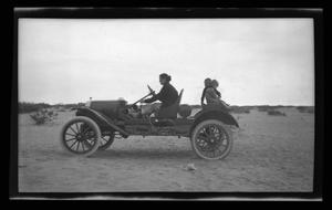 Primary view of object titled '[Irene Biffle Williams with John and Byrd Williams, III, posing on the family car]'.