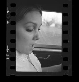 Primary view of object titled '[Closeup of a woman in a car]'.