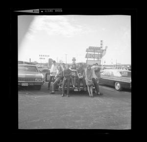 Primary view of object titled '[Kids sitting on a car at Forest Park Lanes Bowling Alley]'.