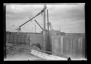 Primary view of object titled '[Photo of men working on a large construction site]'.