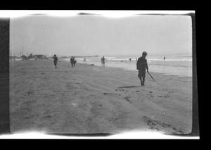 Primary view of object titled '[Photo of people playing on a beach]'.