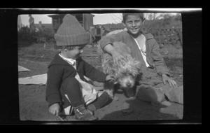 Primary view of object titled '[Charles and Byrd Williams, III, with Brownie the dog]'.