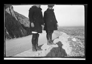 Primary view of object titled '[Photo of John and Byrd Williams III standing on a cliff]'.