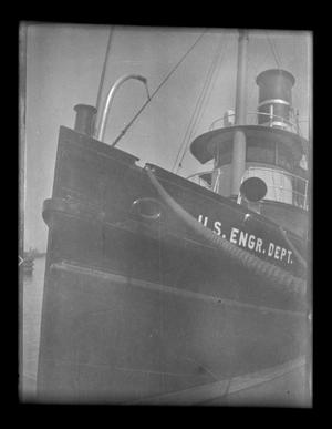 Primary view of object titled '[Photo of a ship in a harbor]'.