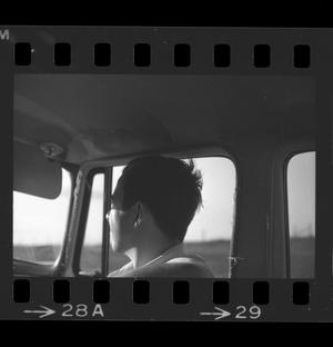 Primary view of object titled '[Man in a car]'.