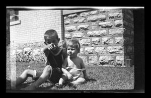 Primary view of object titled '[Photo of John and Charles Williams sitting in grass]'.