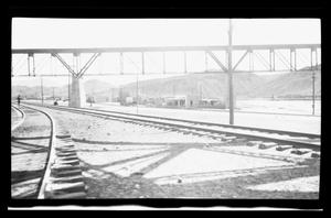 Primary view of object titled '[A photo of a bridge with train tracks running underneath]'.