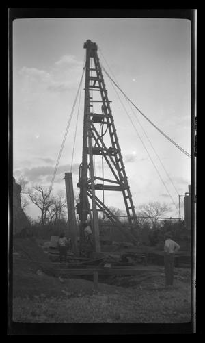 Primary view of object titled '[Photo of a man working on the Leon River Bridge]'.
