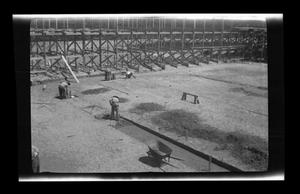 Primary view of object titled '[Photo of men on a construction site]'.