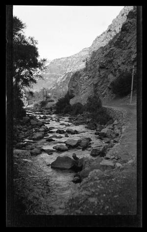 Primary view of object titled '[Photo of a river and mountain landscape]'.