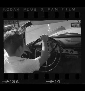 Primary view of object titled '[Photo of a boy sitting in a 1956 Ford]'.