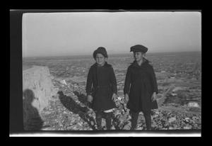 Primary view of object titled '[John and Byrd Williams III standing on top of a cliff]'.