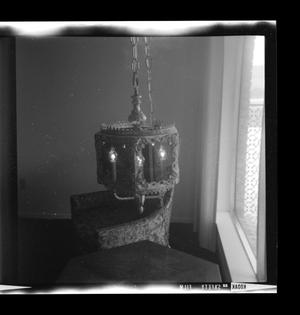 Primary view of object titled '[A hanging light in a living room]'.