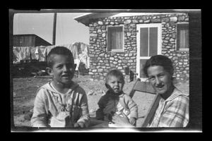 Primary view of object titled '[Photo of Irene Williams with two of her boys]'.