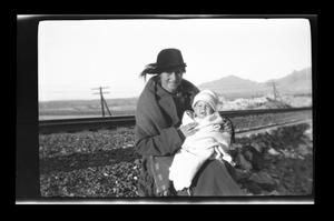 Primary view of object titled '[Photo of Irene Williams holding one of her sons]'.