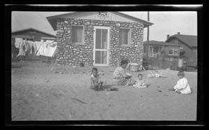 Primary view of object titled '[Irene, Byrd, John, and Charles Williams sitting in front of their house]'.