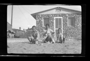 Primary view of object titled '[Irene Biffle Williams sitting with her sons in front of their house]'.