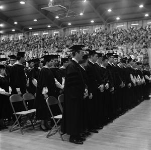 Primary view of object titled '[Graduating Class Standing at Commencement Ceremony]'.