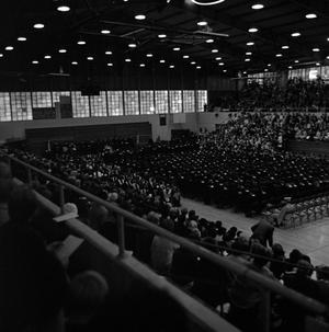 Primary view of object titled '[Family and Friends in Bleachers at Commencement Ceremony]'.