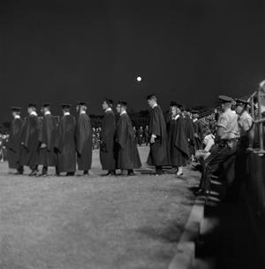 Primary view of object titled '[Graduating Students in Line For Diplomas]'.