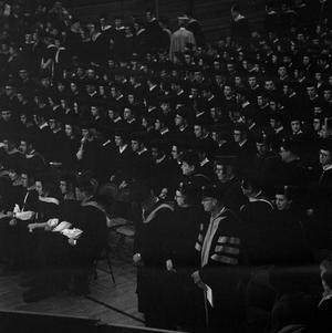 Primary view of object titled '[Faculty Staff and Graduating Students at Commencement Ceremony]'.