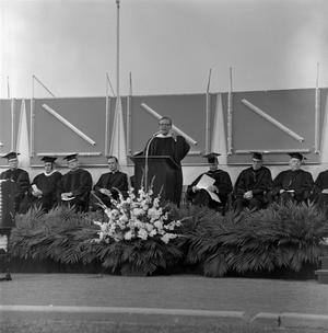Primary view of object titled '[Speaker at Commencement Ceremony]'.