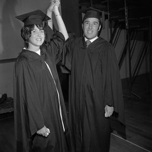 Primary view of object titled '[Two Graduating Students Holding Hands]'.