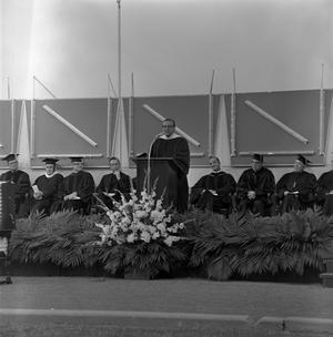 Primary view of object titled '[Faculty Speaker at Commencement Ceremony]'.