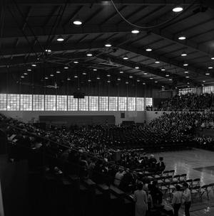 Primary view of object titled '[Family Members seated in bleachers at Commencement Ceremony]'.