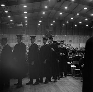 Primary view of [Young men in line to receive diplomas, 3]