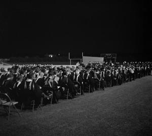 Primary view of object titled '[Faculty Staff Seated at Commencement Ceremony on Fouts Field]'.