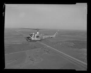 Primary view of object titled '[First flight of the XH-40 #3 over the Hurst plant]'.